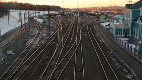 Marshalling railway yard with many lines cargo trains at sunset Russian Railways. Marshalling railway yard with many lines cargo trains at sunset time, Russian stock video footage
