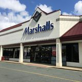 Marshalls storefront. Entrance to Marshalls discount clothing store against blue skies Stock Image