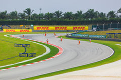 Marshals clean Formula-1 track Stock Images