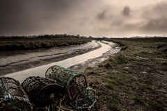 Marshes & Crab Pot Fishing - Lincolnshire, England. Marshes & crab pots on the river on the east coast in Lincolnshire, England royalty free stock photos