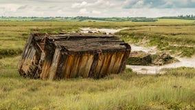 Marshland near the River Crouch, England, UK. Old pontoons in the marshland near the River Crouch, Wallasea Island, Essex, England, UK Stock Images