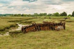 Marshland near the River Crouch, England, UK. Old pontoons in the marshland near the River Crouch, Wallasea Island, Essex, England, UK Stock Photo