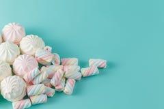 Marshmallow on aquamarine backgound Stock Photos