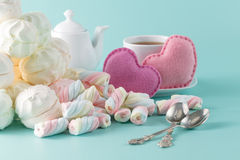 Marshmallow on aquamarine background with cup of tea aтв toy h Stock Image