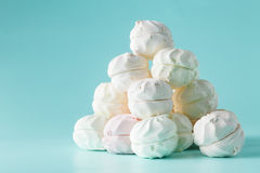 Marshmallow on aquamarine background with cup of tea aтв toy h Royalty Free Stock Photography