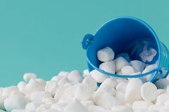 Marshmallow in basket on blue background. Close up Royalty Free Stock Image