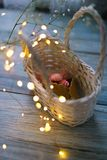 Marshmallow in a basket with a horn with garlands Stock Image