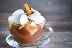 Marshmallow bathes in hot chocolate relaxation concept stock images