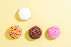 Marshmallow biscuits with colored sugar sprinkles over yellow ba Royalty Free Stock Photos