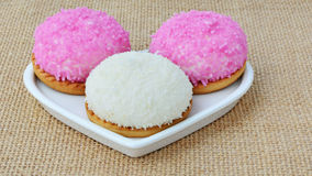 Marshmallow biscuits with pink sugar sprinkles and shredded coconut Stock Photos