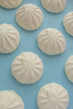 Marshmallow on a blue background. Repeating element Stock Photo