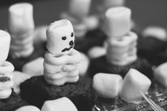 Marshmallow and brownie skeleton treats. Halloween party treats made with brownies, yogurt covered pretzels, and marshmallows - look like skeletons Royalty Free Stock Photo
