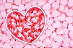 Marshmallow. Candy corn on pink marshmallow for Valentine Day stock photo