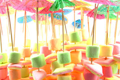 Marshmallow candy on stick with umbrella Royalty Free Stock Photography