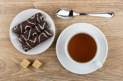 Marshmallow in chocolate, cup of tea, sugar and teaspoon. On wooden table. Top view Royalty Free Stock Photo