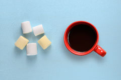 Marshmallow and coffee cup on blue table Royalty Free Stock Images