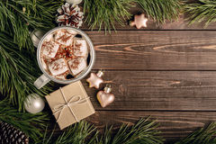 Marshmallow coffee and gift on the wooden table Royalty Free Stock Photos