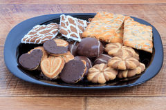 Marshmallow and cookies lying at the black plate. Objects on wood table Stock Photo