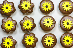 Marshmallow cookies with yellow flowers Royalty Free Stock Photography
