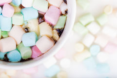 Marshmallow in the cup. Lots of colorful marshmallow in the cup of coffee royalty free stock photos