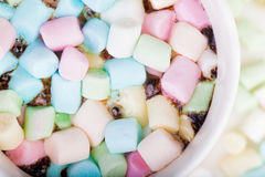 Marshmallow in the cup. Lots of colorful marshmallow in the cup of coffee royalty free stock photo