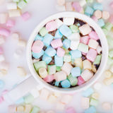 Marshmallow in the cup. Lots of colorful marshmallow in the cup of coffee royalty free stock images