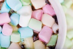 Marshmallow in the cup. Lots of colorful marshmallow in the cup of coffee royalty free stock image