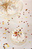 Marshmallow dessert. On a white table with scattered decoration Stock Photography