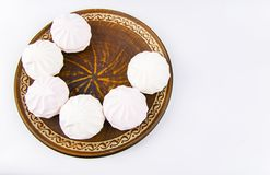 Marshmallow dessert on a brown dish, white background royalty free stock images
