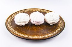 Marshmallow dessert on a brown dish, white background stock image