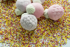 Marshmallow in form of strawberries, and sugar balls Royalty Free Stock Photography