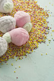 Marshmallow in form of strawberries, and sugar balls Stock Image