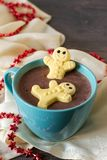 Marshmallow gingerbread men in hot chocolate Stock Photo