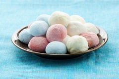 Marshmallow handicraft. Of blue, white, red and yellow color Royalty Free Stock Image