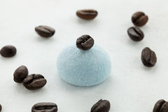 Marshmallow handicraft and coffee. Marshmallow craft of different colors with the berries of coffee Stock Photos