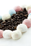 Marshmallow handicraft and coffee. Marshmallow forming a heart with coffee berries Stock Photo