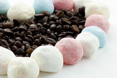Marshmallow handicraft and coffee. Marshmallow forming a heart with coffee berries Royalty Free Stock Image