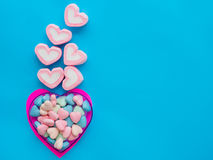 Marshmallow in a heart frame love concept. Marshmallow in a heart frame on Valentine`s Day love concept on blue sky background Stock Images