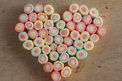 Marshmallow heart on wooden background.  Royalty Free Stock Image