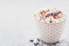 Marshmallow hot drink decorated with lavender flowers Stock Images