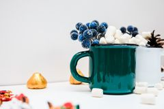 Marshmallow in an iron mug. On a white background in winter stock photos