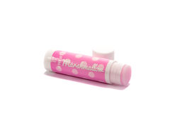 Marshmallow lip balm. A pink, marshmallow flavoured lip balm isolated on a white background stock photo
