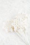 Marshmallow lolly snowflake on white festive backround Stock Images
