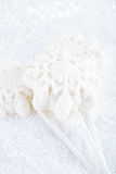 Marshmallow lolly snowflake on white festive backround Royalty Free Stock Photo