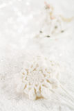 Marshmallow lolly snowflake on white festive backround Stock Images