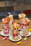 Marshmallow milk shake cocktails with whipped cream, cookies, waffles, treats Royalty Free Stock Images