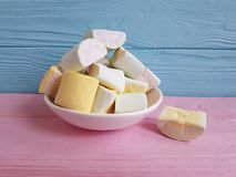 Marshmallow on a pink wooden yellow lots sugar different. Marshmallow many on a pink wooden yellow sugar different stock photography