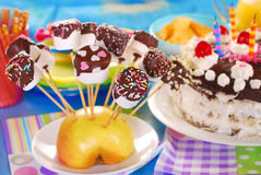 Marshmallow pops with chocolate and colorful sprinkles royalty free stock photography