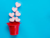 Marshmallow in a red bucket. On Valentine`s Day love concept on blue sky background Stock Photos