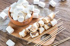 Marshmallow skewers on the wooden board Royalty Free Stock Photos